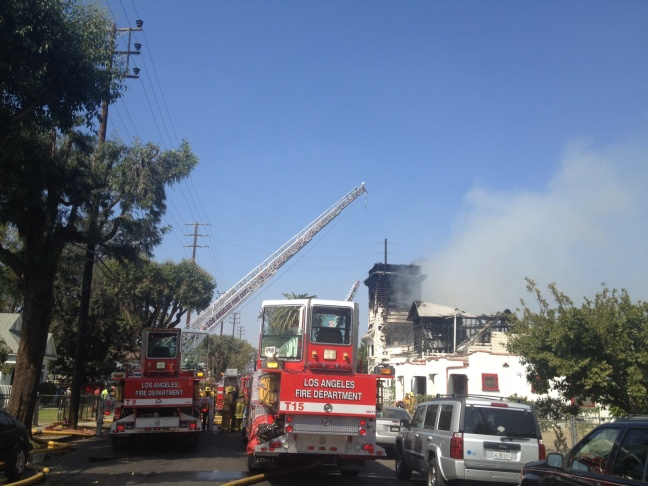 At least one firefighter was rescued after he may have been trapped in a burning South L.A. church.