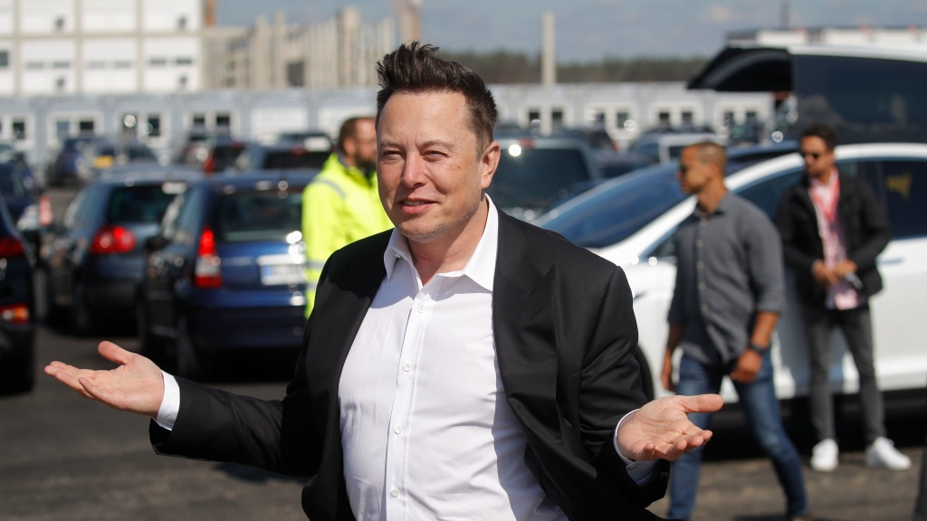 Tesla CEO Elon Musk gestures as he arrives to visit the construction site of a future Tesla plant near Berlin on Sept. 3. Musk is now the world's second-richest person, according to Bloomberg.