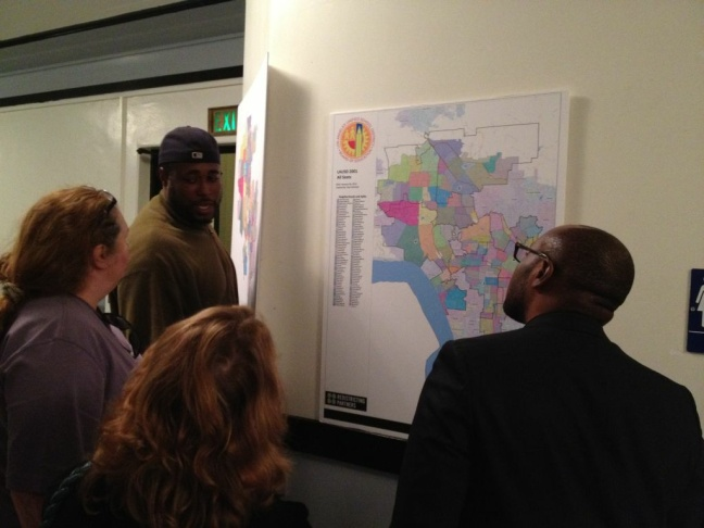 Members of the public at a Redistricting Commission meeting Tuesday night at Hamilton High School looking at proposed maps.