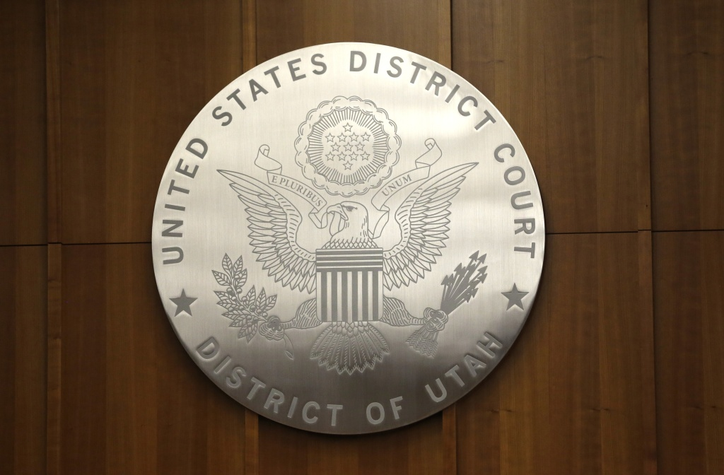 A United States District Court emblem is seen in a courtroom as members of the media tour the new Salt Lake City Federal Courthouse Wednesday, April 9, 2014. A spokeswoman for the U.S. attorney in Utah says a shooting has left at least one person injured at a federal courthouse in downtown Salt Lake City Monday, April 21, 2014.
