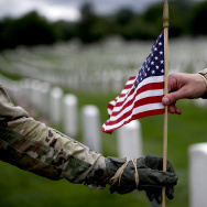 "Fallen Soldiers Honored With ""Flags In"" Tradition At Arlington Nat'l Cemetery"