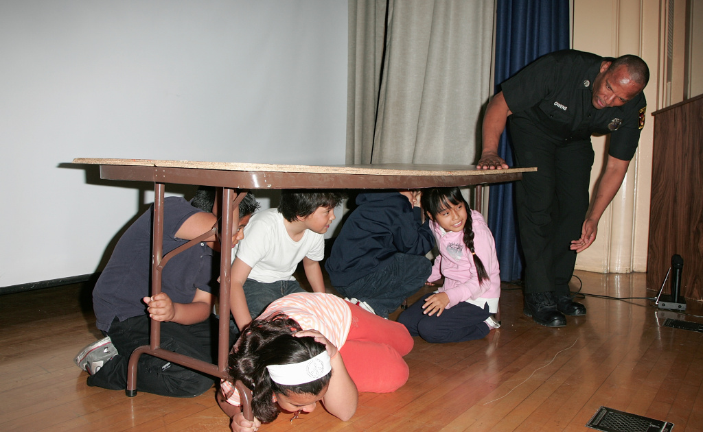 4th graders participate in an earthquake drill with LAFD Captain Steven Owens. Will you be participating in this year's