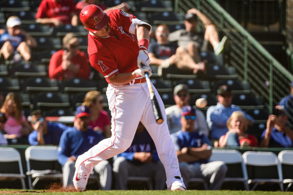 Mike Trout #27 of the Los Angeles Angels lines out in the spring training game against the Texas Rangers at Tempe Diablo Stadium on February 28, 2019 in Tempe, Arizona