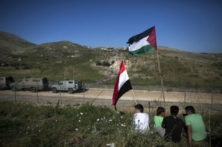 Pro-Palestinian demonstrators watch from the Israeli side as Pro-Palestinian demonstrators storm a ceasefire line.