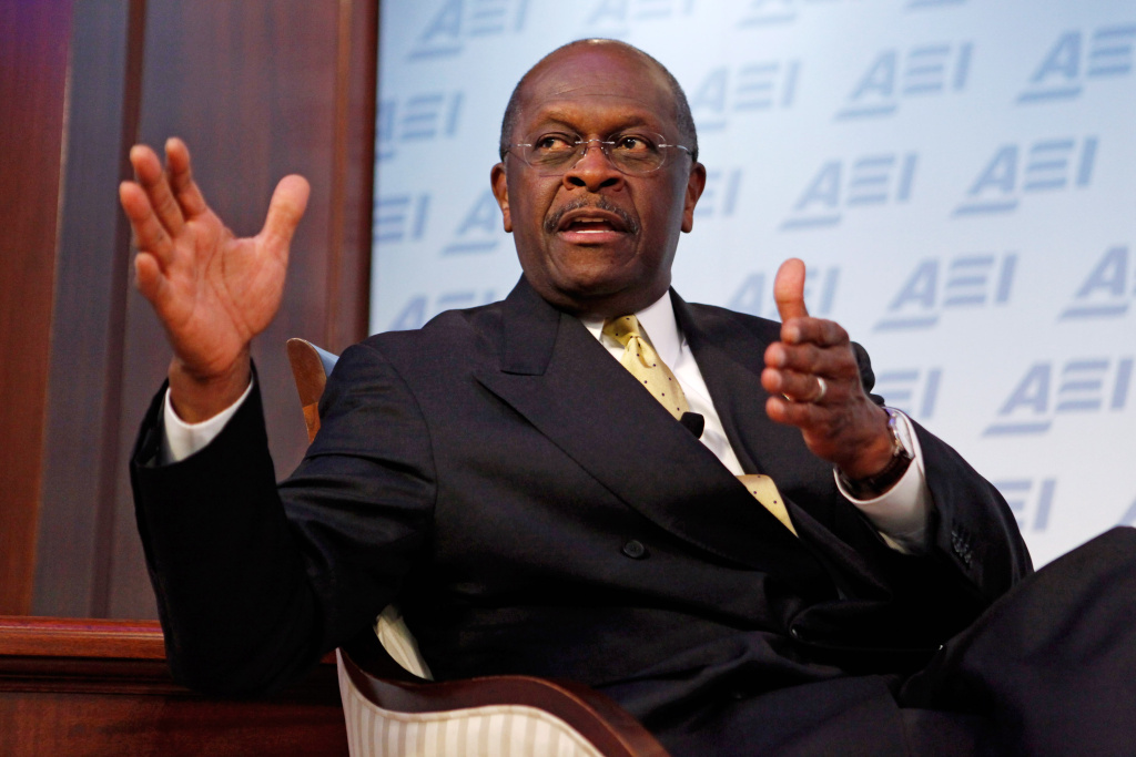 Republican presidential candidate Herman Cain participates in a discussion about his 9-9-9 tax plan at the American Enterprise Institute October 31, 2011, in Washington, DC. POLITICO.com reported Sunday that the National Restaurant Association paid settlements to two female employees who accused former Godfather's Pizza chief executive of harassment when he was president of the association in the 1990s.