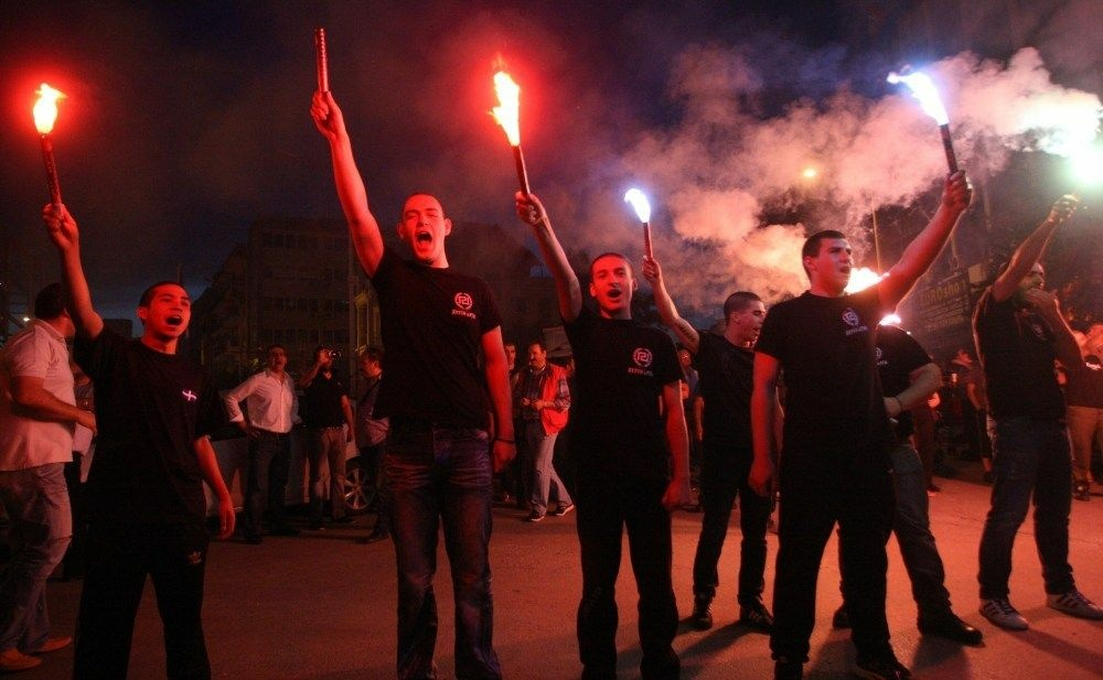 Members of the Greek neo-Nazi Golden Dawn Party celebrate in Thessaloniki on Sunday.