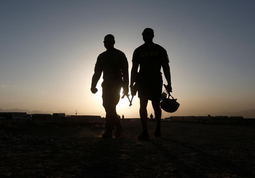 U.S troops walk at their base in Logar province, Afghanistan August 4, 2018.