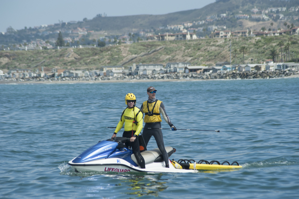 Chris Lowe of California State University, Long Beach, joins San Clemente lifeguard Rod Mellott on a jet ski while looking for sharks during a research project on shark behavior near the San Clemente pier, June 28, 2017.
