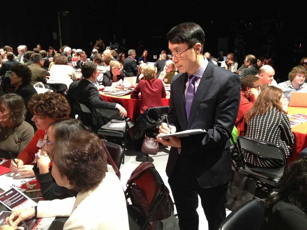 Otis College President Samuel Hoi takes notes during a discussion about the creative economy at Google's YouTube space in L.A.