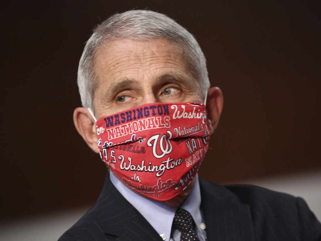Dr. Anthony Fauci, director of the National Institute for Allergy and Infectious Diseases wore a Washington Nationals face mask before testifying at a congressional hearing on June 30. The team announced he will throw out the ceremonial first pitch at their season opener on Thursday.