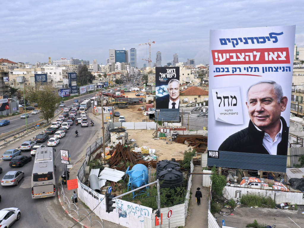 Election campaign billboards show Israeli Prime Minister Benjamin Netanyahu (right) and rival candidate Benny Gantz, in Bnei Brak, Israel, on Feb. 23. The sign in the foreground, for Netanyahu's Likud party, reads