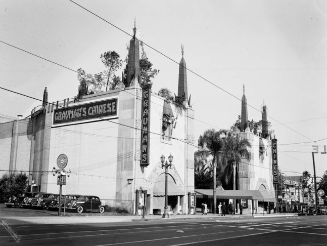 Exterior view of Grauman's Chinese Theatre, where a premiere is taking place, 1945. A large banner to the right of the theater announces the film,