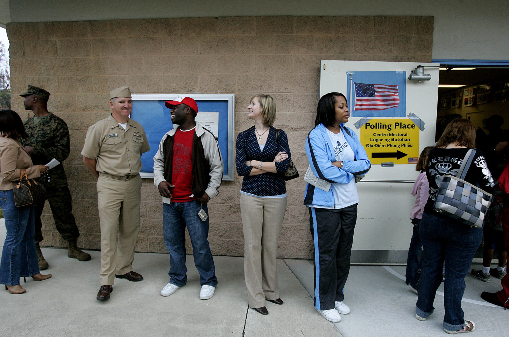 Voters wait in line to cast their ballots at a polling station in San Diego, California.