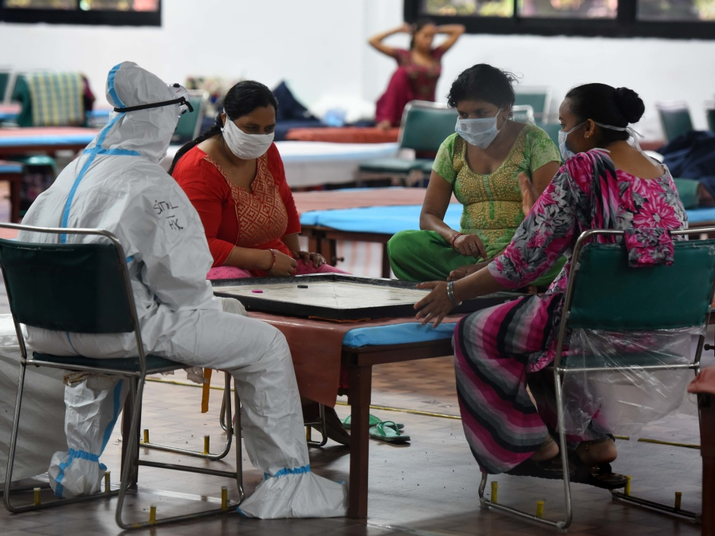 Coronavirus patients play a game of carrom inside the COVID-19 Care Centre at CWG Village Sports Complex in New Delhi on Thursday.