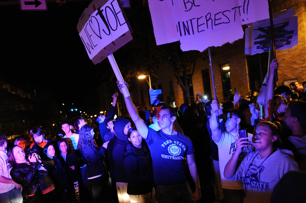 Students and those in the community fill the streets and react after football head coach Joe Paterno was fired during the Penn State Board of Trustees Press Conference, in downtown Penn State, November 9, 2011.