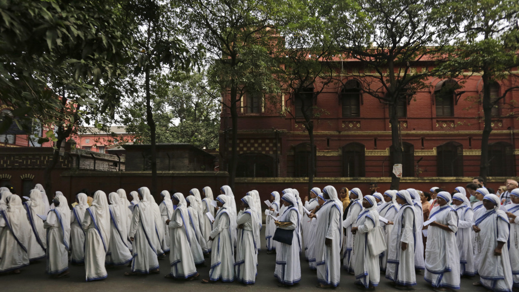 Nuns of the Missionaries of Charity, the order founded by Mother Teresa, who was canonized two years ago, walk in annual Corpus Christi procession organized on the Feast of Christ the King in Kolkata, India, in 2016.