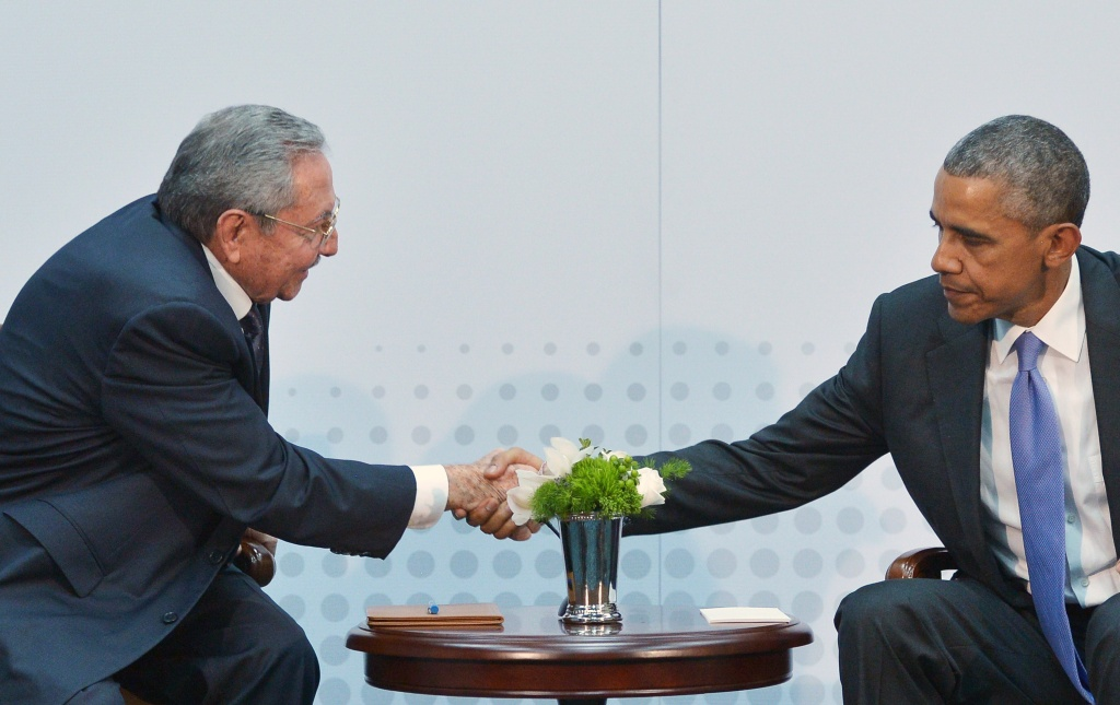 US President Barack Obama (R) shakes hands with Cuba's President Raul Castro during a meeting on the sidelines of the Summit of the Americas at the ATLAPA Convention center on April 11, 2015 in Panama City.