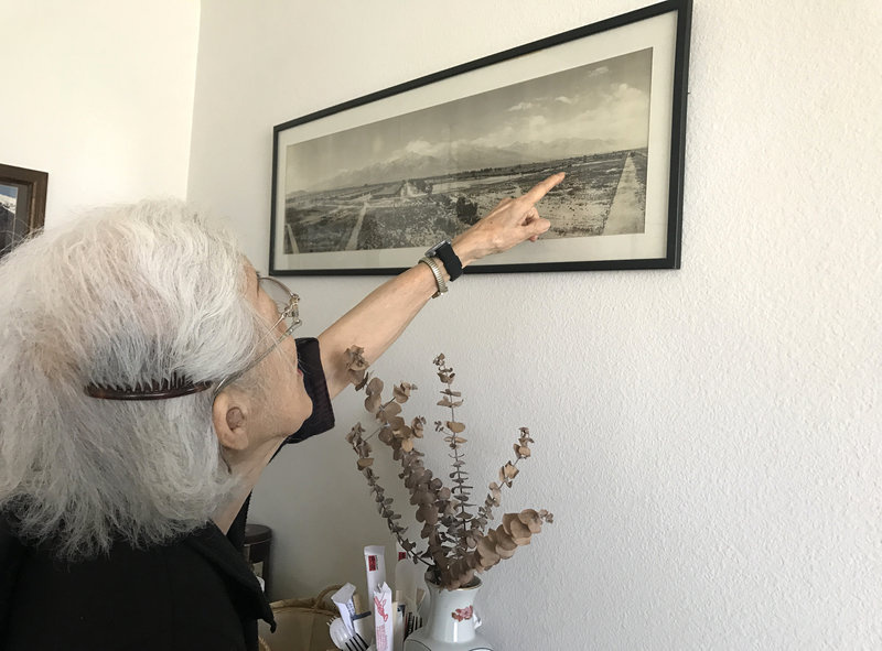 Aiko Herzig-Yoshinaga was a high school senior when she entered the Manzanar internment camp. Now 92, she points to the place in Manzanar, near Death Valley in California, where she lived.