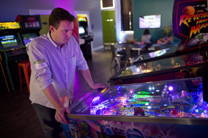 Will Stifel plays Monster Bash Pinball during his lunch break at Neon Retro Arcade in Pasadena on Wednesday afternoon, Feb. 4. The space opened in Old Town on Jan. 30.