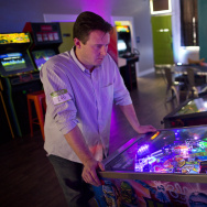 Will Stifel plays Monster Mash Pinball during his lunch break at Neon Retro Arcade in Pasadena on Wednesday afternoon, Feb. 4. The space opened in Old Town on Jan. 30.