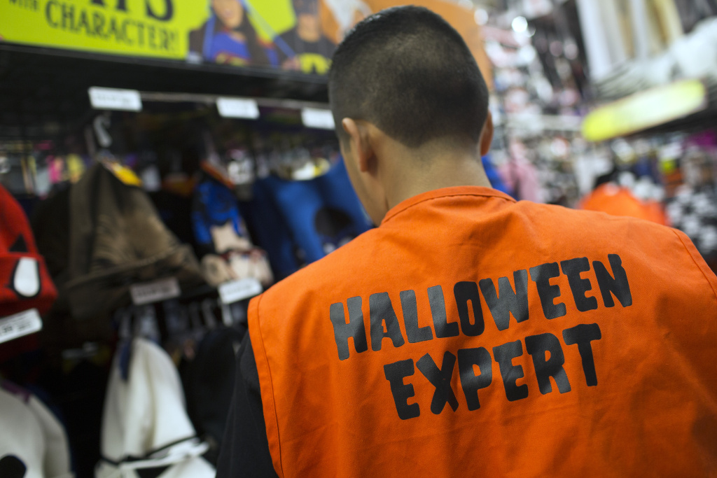 Employees at Party City wear