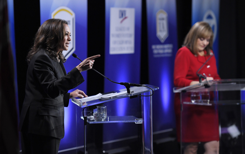 California U.S. Senate Democratic candidate California Attorney General Kamala Harris, left, speaks as Congresswoman Loretta Sanchez, center, listens during a debate.