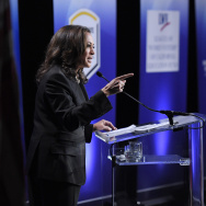 California U.S. Senate Democratic candidate California Attorney General Kamala Harris, left, speaks as Congresswoman Loretta Sanchez, center, listens during a debate.