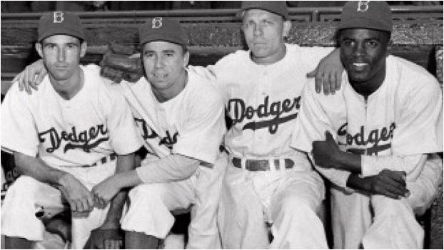 From left are Brooklyn Dodger players John Jorgensen, Pee Wee Reese, Ed Stanky and Jackie Robinson, in an AP file photo from April 15, 1947 - the day Robinson became the first black player in Major League Baseball history.