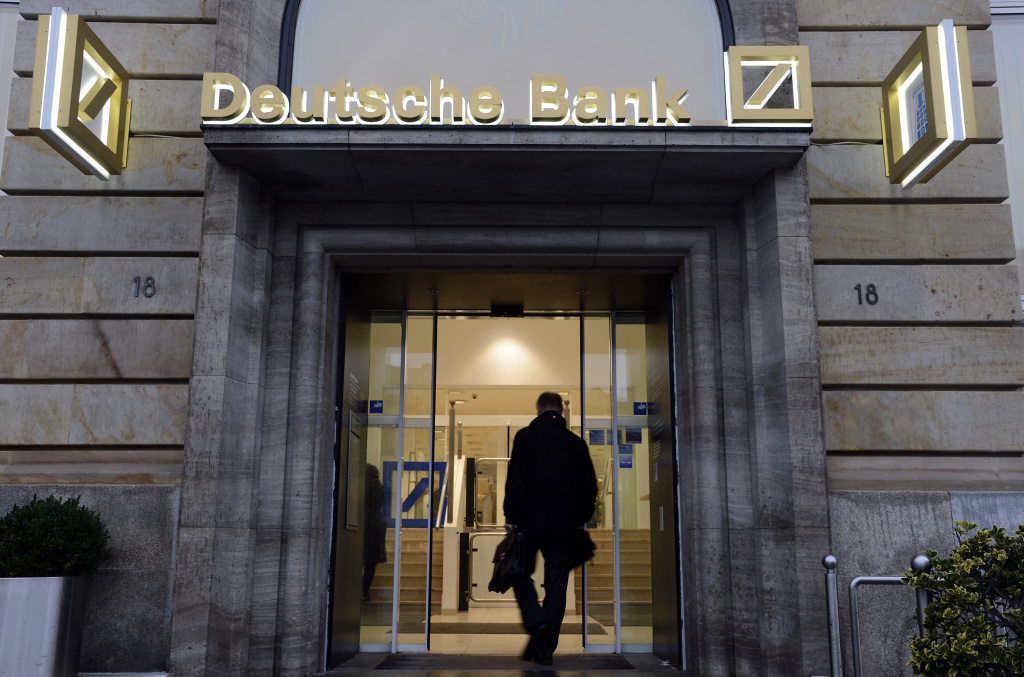 A man enters a branch of the Deutsche Bank on January 31, 2013 in Frankfurt am Main, Germany. The annual results press conference for 2012 takes place on Thursday, January 31, 2013.