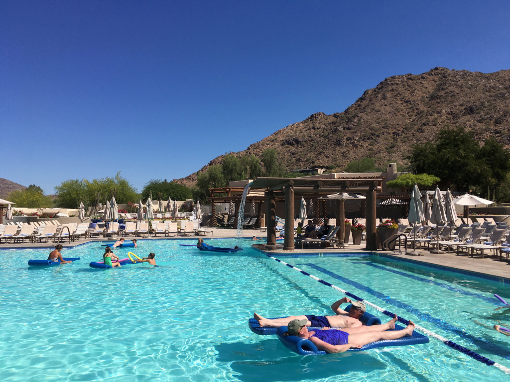 Hotel guests cool off at the pool at the JW Marriott Scottsdale Camelback Inn Resort and Spa in Paradise Valley, Ariz., on Sunday, June 19, 2016. States in the Southwest are in the midst of a summer heat wave as a high pressure ridge bakes Arizona, California and Nevada with extreme, triple-digit temperatures.