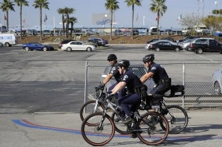 Los Angeles Police Department officers patrol the parking lot outside Dodger Stadium prior to the Dodgers' game against the St. Louis Cardinals on April 14, 2011, in Los Angeles. Bryan Stow, the father of two, was beaten in a parking lot outside Dodger Stadium after the teams' March 31 season opener and remains hospitalized in Los Angeles in a medically induced coma.