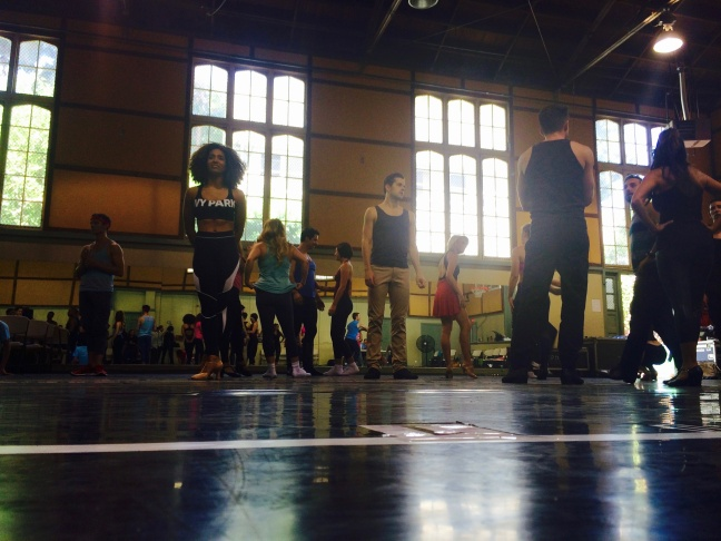 """The cast of """"A Chorus Line"""" warms up for rehearsal in the gym at Hollywood United Methodist Church."""