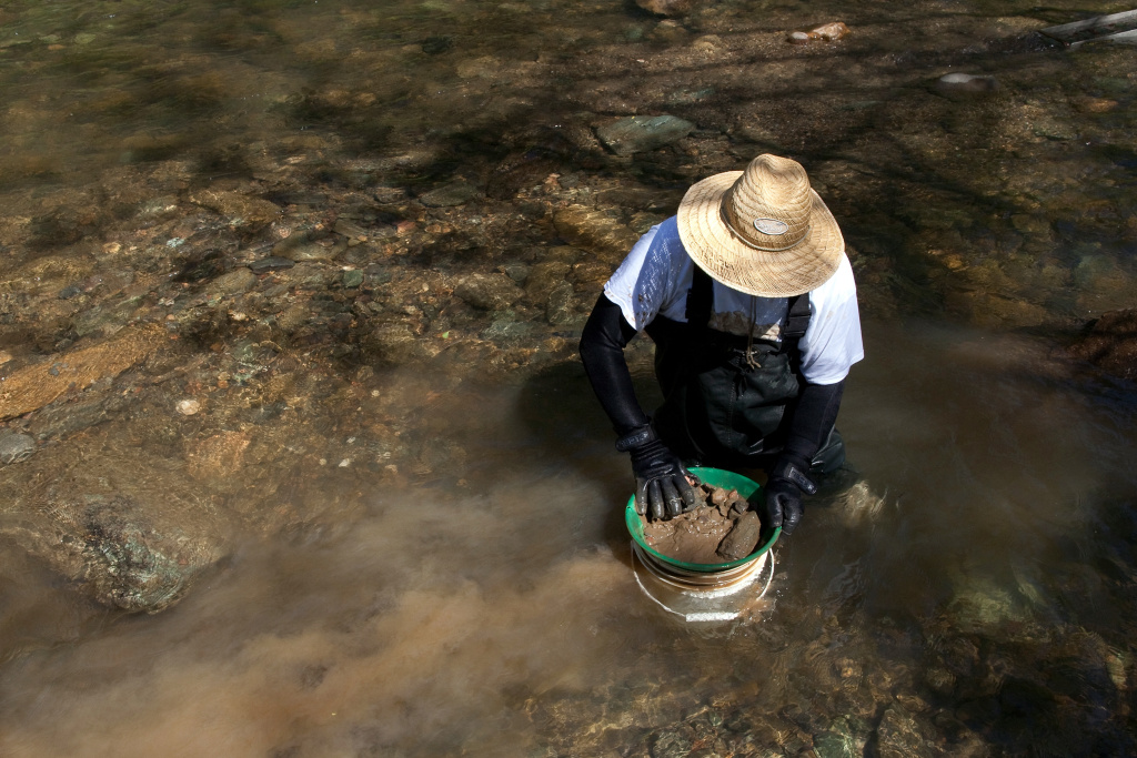 Scott Sprague of Manassas, Virginia looks for gold in Woods Creek on April 29, 2011 in Jamestown, California.