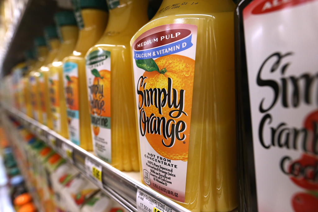 Containers of orange juice are displayed at Cal-Mart Grocery on March 27, 2014 in San Francisco, California.