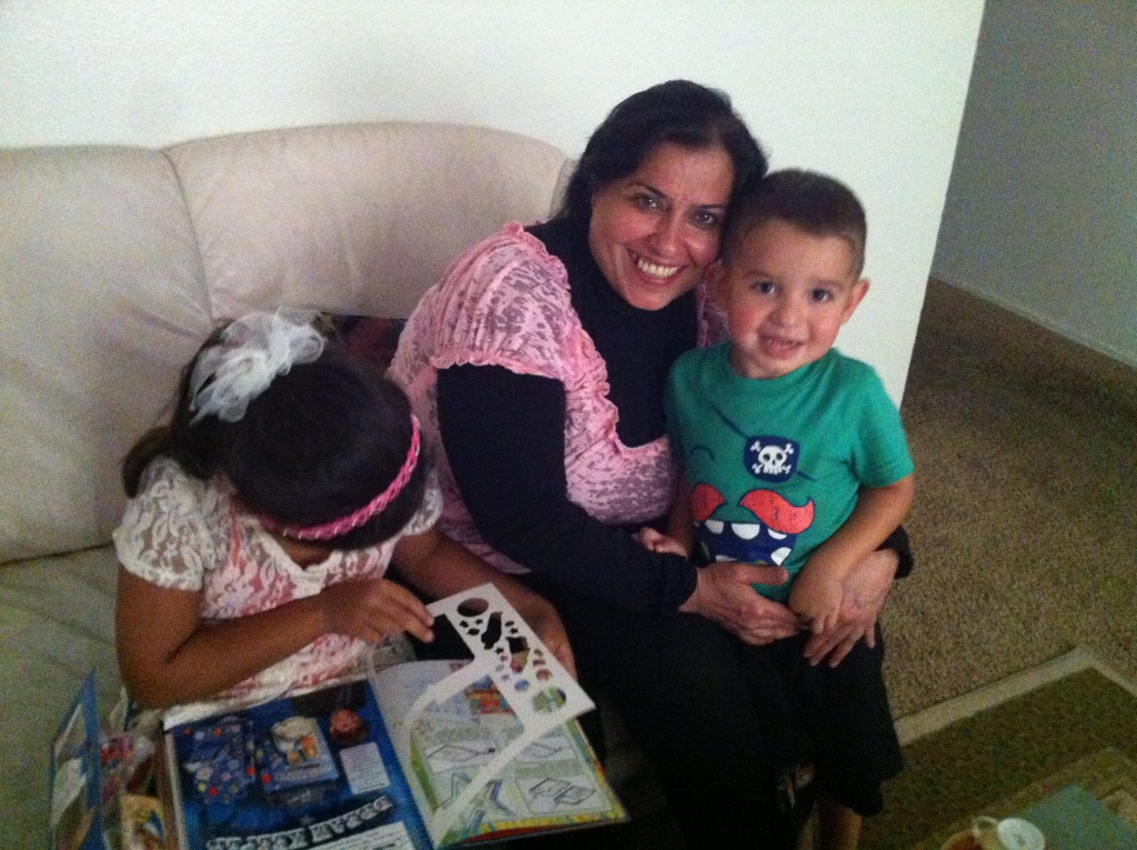 Maladh Mohammed Ali with her niece's son at their apartment in El Cajon. Maladh's son was killed while working as an interpreter for U.S. troops in Iraq.