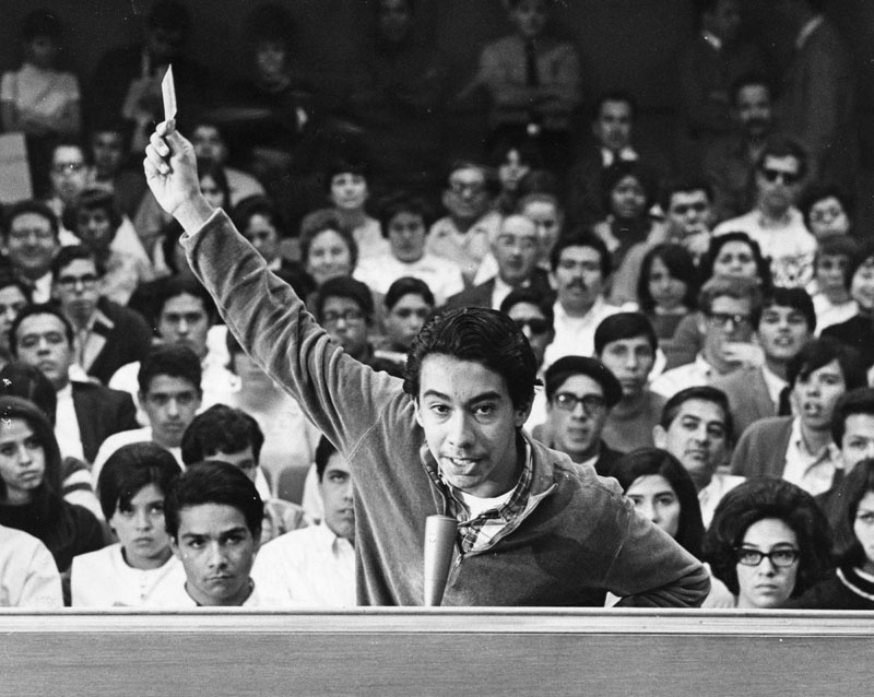 Wilson High School student Peter Rodriguez speaks during a meeting of the L.A. Unified School Board on March 12, 1968. During his speech, he waved his intact draft card to prove his participation in a student protest was not communist-inspired.
