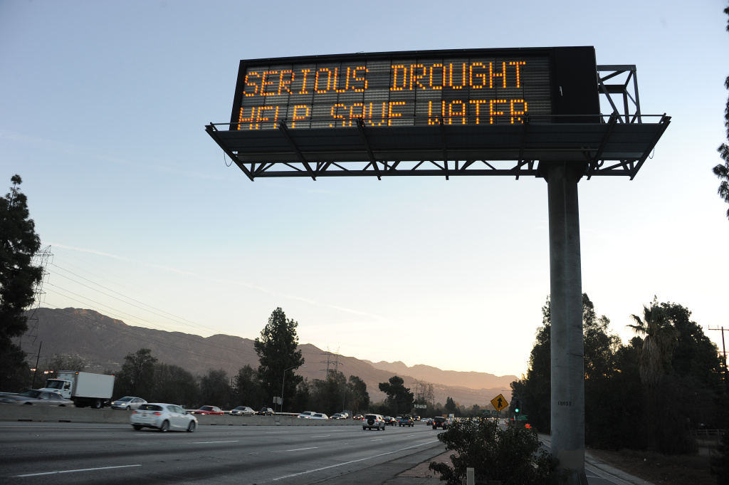 A sign over a highway in Glendale, California warns motorists to save water in response to the state's severe drought, Feb. 14, 2014. Two new bills will help Californians save water long-term, not just during a drought emergency.