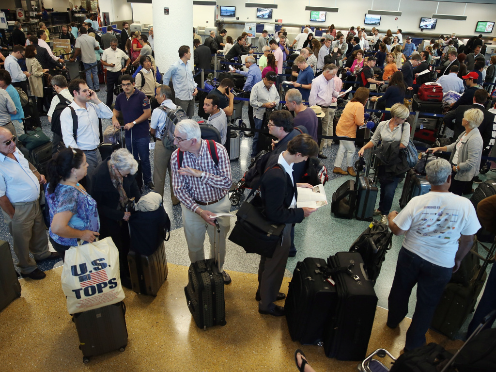 An amendment to the Senate immigration reform bill approved Monday in the Senate Judiciary Committee would require fingerprinting systems at the nation's busiest airports to track foreigners leaving the country.