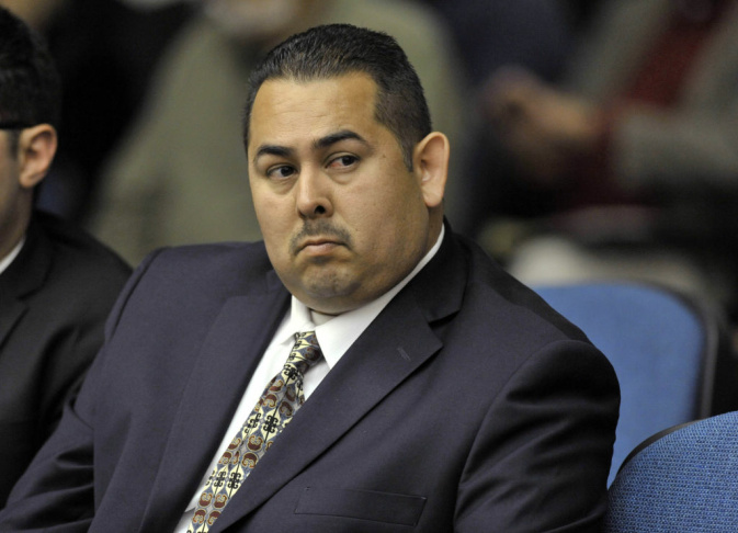 Former Fullerton police officer Manuel Ramos, one of the defendants, listens at the preliminary hearing of the Kelly Thomas beating death case. (File photo).