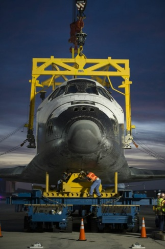 The Over Land Transporter (OLT) is mated to the space shuttle Endeavour not long after Endeavour was demated from the NASA 747 Shuttle Carrier Aircraft (SCA), Saturday, Sept. 22, 2012, at Los Angeles International Airport.