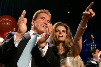 Arnold Schwarzenegger and Maria Shriver look out into the crowd of supporters during his California gubernatorial victory celebration Tuesday, Nov. 7, 2006 in Beverly Hills.