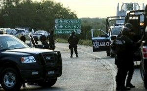 Mexican officers block the road between Reynosa on the U.S.-Mexico border and Monterrey, May 13, 2012