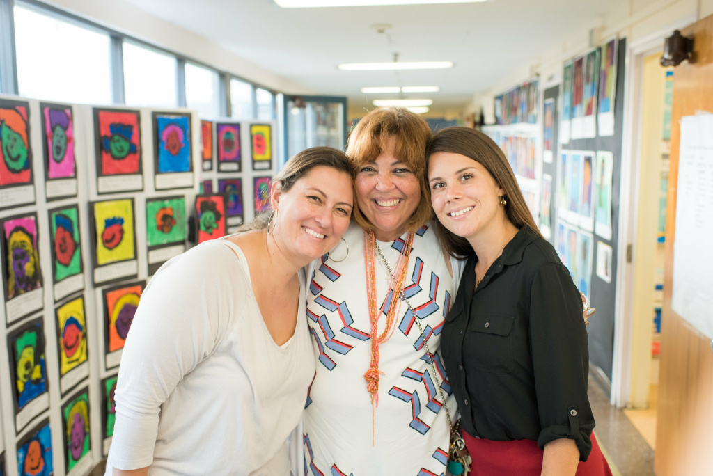 Arts specialist Cathryn Deering, principal Akida Kissane Long and teacher Charlotte Borgen at the school's portrait night.