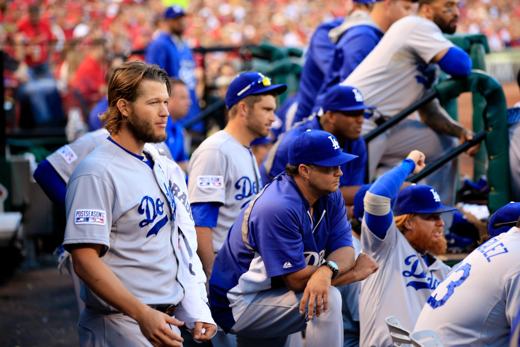 Clayton Kershaw #22 of the Los Angeles Dodgers looks on from the dugout in the sixth inning against the St. Louis Cardinals in Game Four of the National League Divison Series at Busch Stadium on Oct. 7, 2014 in St Louis, Missouri.