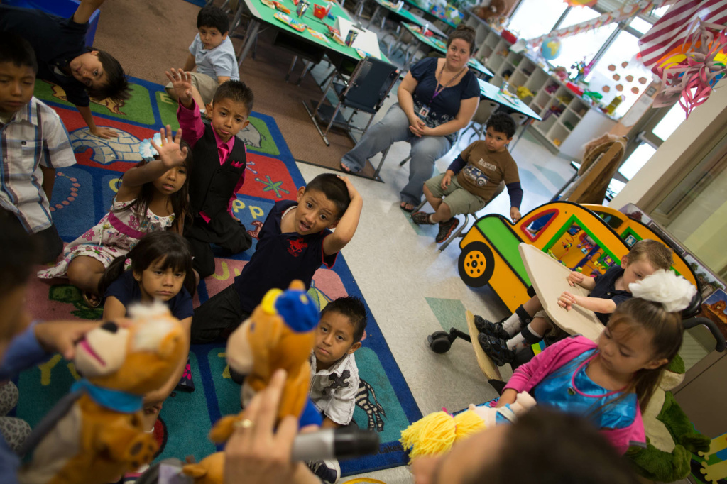 Students prepare to read a story with their teacher at the end of a year of classes at Stanley Mosk Elementary School.