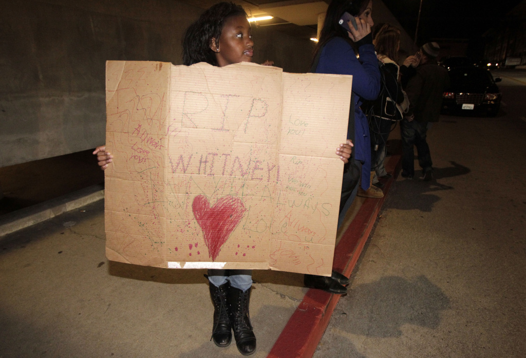 Annika Sillemon, 8, fan of Whitney Houston, is seen outside the Beverly Hilton Hotel Saturday Feb. 11, 2012 in Beverly Hills Calif. Whitney Houston, who ruled as pop music's queen until her majestic voice and regal image were ravaged by drug use, erratic behavior and a tumultuous marriage to singer Bobby Brown, died Saturday. She was 48.