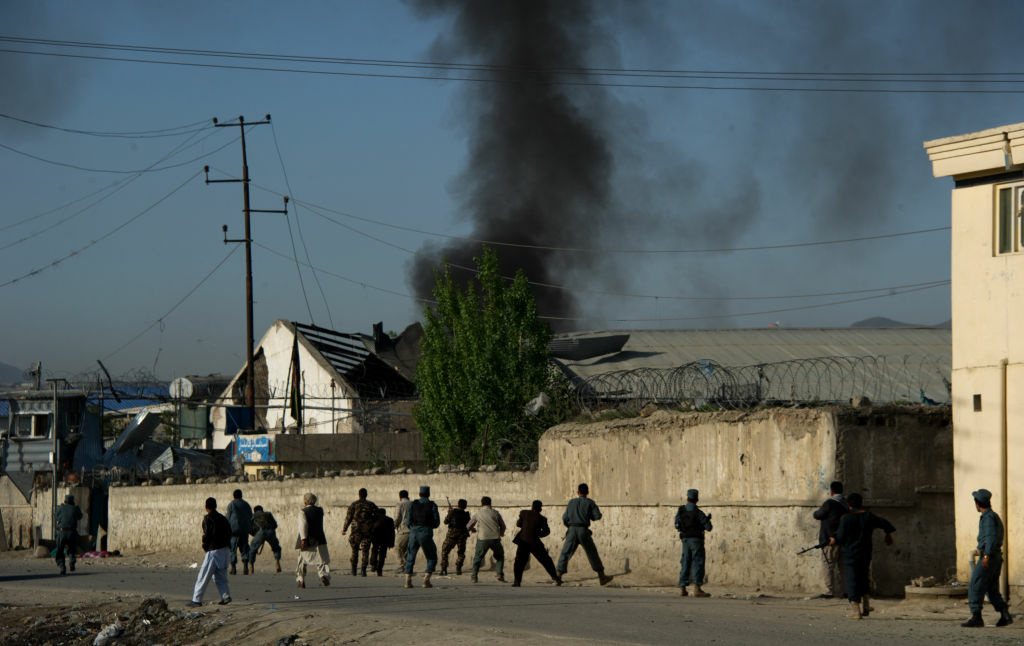 Afghan Special Forces arrive at the site of a suicide bomb attack in Kabul on May 2, 2012. Taliban insurgents claimed responsibility for the suicide attack in the Afghan capital Kabul.