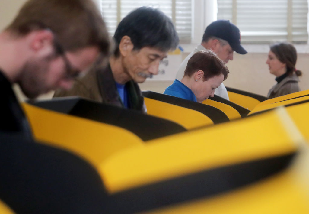 Voters prepare their ballots in voting booths during early voting for the California presidential primary election at an L.A. County 'vote center' on March 1, 2020 in Los Angeles, California.