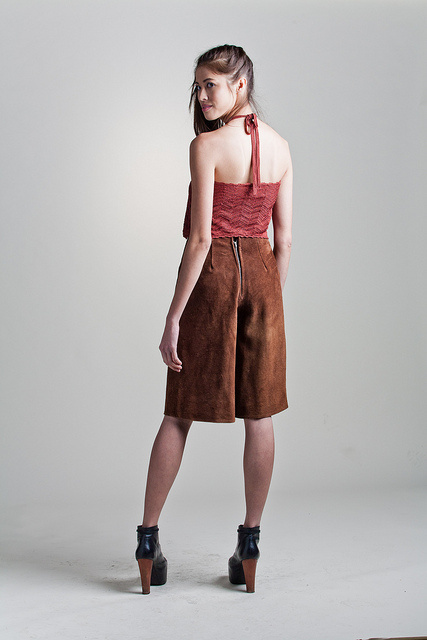 A model wears brown suede culottes