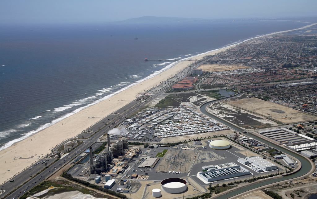 Poseidon Water has proposed a desalination plant in Huntington Beach and wants to use existing open-water intake for collecting and discharging water. The California Coastal Commission staff is recommending approval of the project but with conditions that include using subsurface intakes. (Photo: Artist rendering of Poseidon Water desalination plant proposed for Huntington Beach, Calif.)